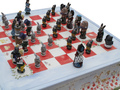 Alice_chess_set_on_plinth__detail__2_small_carousel