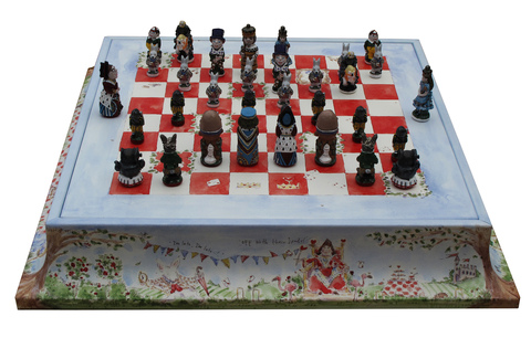 Alice_chess_set_on_plinth_queen_of_hearts_side__main